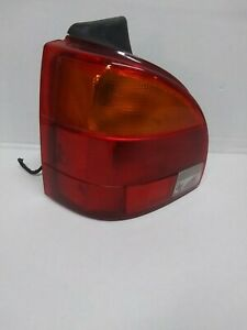2000-01 SATURN SW2 DRIVER SIDE TAIL LIGHT  OEM