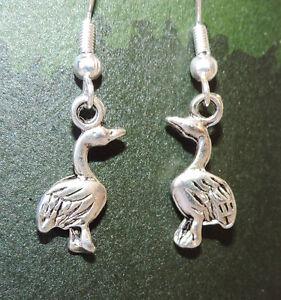 Silver plated swan dangle earrings on silver plated hook
