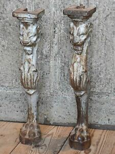 Two table legs with lions head and claw feet