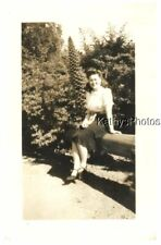FOUND B&W PHOTO G_5557 WOMAN SITTING ON A LOG IN WOODED AREA