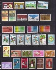 stamps  Suriname in sets and singl   see 2 scans