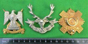 Three UK Scots army cap badges.