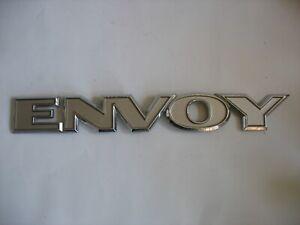 Used GM GMC ENVOY EMBLEM 2002-05 FRONT DOOR/REAR LIFTGATE OEM BADGE