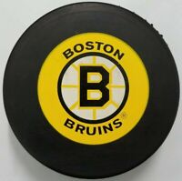 BOSTON BRUINS HOCKEY PUCK NHL MADE IN SLOVAKIA OFFICIAL VEGUM TRENCH MFG.