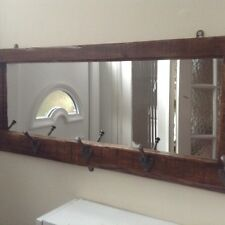 Coat rack with cast iron pegs and mirror