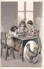 CPA FANTAISIE GROUPE D'ENFANTS JEUX DE DES SUR LA TABLE