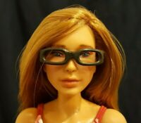 Pamela, a custom Mattel action doll with glasses, rerooted hair, and new face up