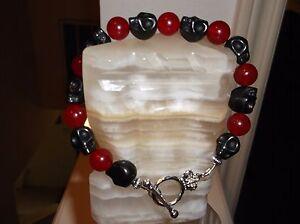 Men's 9 1/2' 12 MM Black Turquoise Skull Head And 10 MM Red Jade Beaded Bracelet