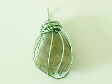 Labradorite gemstone wire wrapped pendant in sea foam green wire.