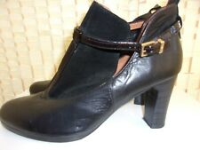 Size 5 (38) black leather shoes with ankle strap.
