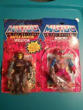 original masters of the universe action figures  1983 skeletore...1984 roboto.