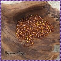 50 grs de Perles de rocailles 2,1mm, Dark Topaz Lined Marque Ornella