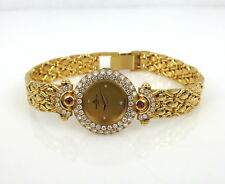 NEW OLD STOCK LADIES DIAMOND 18KT. GOLD AND RUBY BAUME MERCIER WATCH