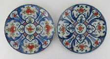 Near pair of London delftware plates with red hatched ground c1720