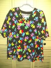White Cross Autism puzzle piece Scrub Top. Size 2X.