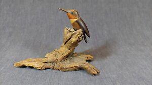 HAND CARVED MULTI-WOOD BIRD ON DRIFTWOOD BASE, SIGNED