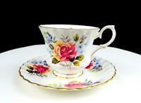 "QUEEN ANNE ENGLAND ROSE AND BLUE FLOWER 2 7/8"" FOOTED CUP AND SAUCER"