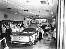 "1957 Chevrolet""s on display on showroom floor 8 x 10 photograph"