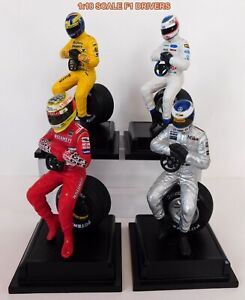 (4) 1:18 SCALE F1 CUSTOM RESIN RACE CAR DRIVERS WITH BASES