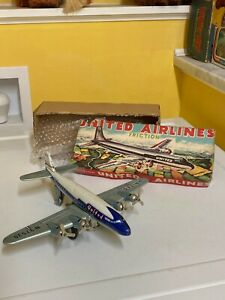 VINTAGE FRICTION TIN UNITED AIRLINES DC-7 MAINLINER. FULLY WORKING WITH BOX!