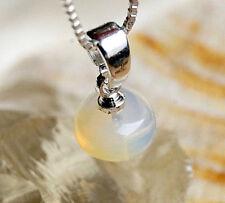 Welo Opal Äthiopien A´+ 1,5 ct Silber Kettenanhänger 1,5 cm lang Klein Feueropal