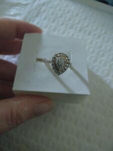 9ct yellow gold Bevilles pear halo diamond ring