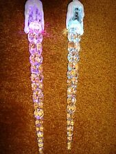ICICLE LIGHTS THAT LIGHT UP DIFFERENT COLORS10 INCHES LONG LOT OF 2