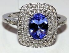 10CT10KT WHITE GOLD OVAL 1.25CT TANZANITE & 0.33CT  DIAMOND CLUSTER RING