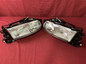 NOS OEM Buick Riviera Headlamp 1995 - 96 Pair 16525993 16525994