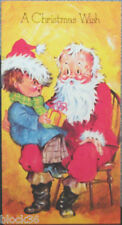 "Greeting postcard ""A CHRISTMAS WISH"" Boy sits on Santa's lap and wears his hat"