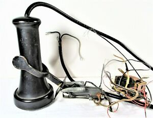 ANTIQUE EAR PIECE WITH ITS CRADLE FOR WOOD WALL TELEPHONE, WESTERN ELECTRIC CO.