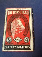 old match box top -  the horse head .made in india