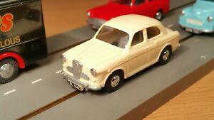 Minic Motorways pick up shoes & resin Wolseley 1500 body.