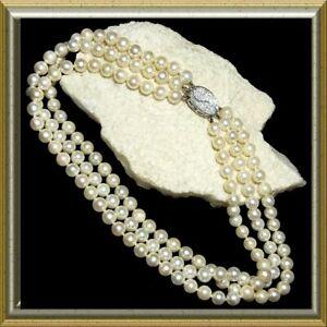 3 strand pearl necklace, platinum, .88 carat diamond, IGI certificate M-F