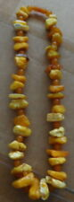 Gioielli e gemme di ambra naturale rotondo
