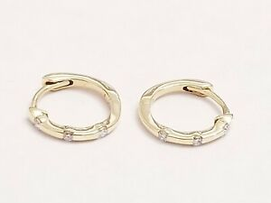 14 kt yellow gold small hoops 3 small diamonds 06ct total weight 8mm ef dn