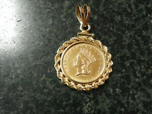 1856 $1 GOLD LIBERTY COIN WITH 14K BEZEL