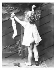 1900s era vintage photo-Cute little girl hangs stocking_bare bottom-8x10 in.