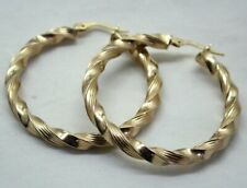 Large Pair Of 9 carat Gold Ribbon Twist Hoop Earrings