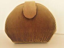 Ladies evening bag tiny clamshell shaped gold bag Bijou Terner the bare minimum