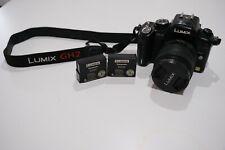 Panasonic LUMIX DMC-GH2 Mirrorless Digital Camera w/ 14-42mm Lens, 2 Batteries