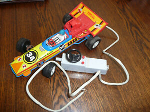 EARLY TIN PLASTIC WIRE CONTROLLED RACE CAR,