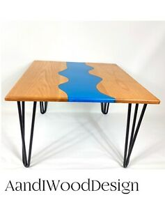 Set of two Live edge resin river coffee tables . Oak and resin coffee table.