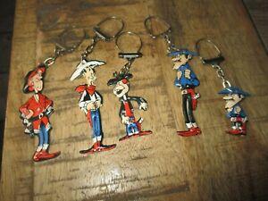 Lucky Luke-Lot portes clé publicitaire- Lessive OMO-5 personnages-Années 60