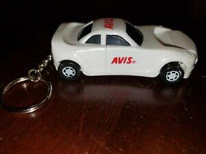 RARE KEY CHAIN WHITE SPORTS CAR HEADLIGHT LIGHTS UP AVIS TRAVEL AGENTS