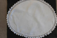 Vintage oval white linen cloth with embossed leaf pattern and crochet edges.