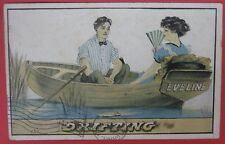 ANTIQUE POSTCARD-DRIFTING-ROMANTIC COUPLE IN EVELINE ROW BOAT
