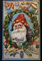 Primitive~Hooded ~Santa Claus with Toys & Wreath~Antique~Christmas Postcard-s705