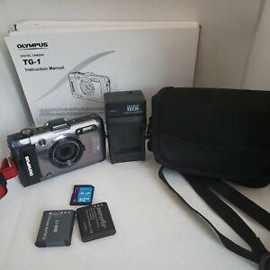 Olympus TOUGH TG-1, Water / Shock Resistant 12 MP Camera Case 2 batteries manual