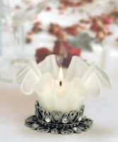 Glass candle holder with interlocking hearts